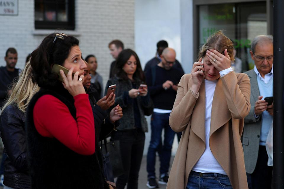<p>Concerned eyewitnesses frantically phone loved ones near Parsons Green station in the aftermath of the blast. (Reuters) </p>