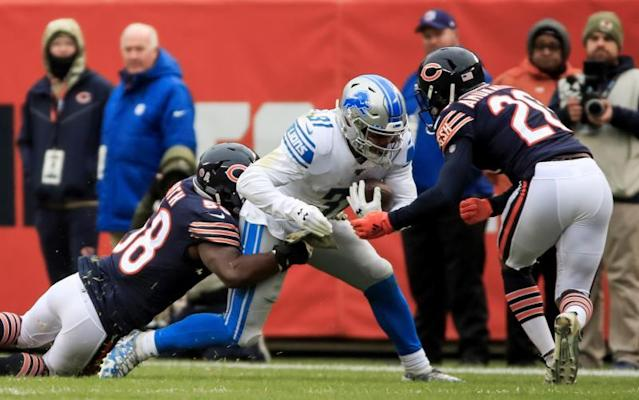 Detroit Lions running back Ty Johnson (C) is tackled by Chicago Bears inside linebacker Roquan Smith (L) and Chicago Bears cornerback Prince Amukamara (R) during the NFL game between the Detroit Lions and the Chicago Bears at Soldier Field in Chicago, Illinois, USA, 10 November 2019. EFE/EPA/TANNEN MAURY