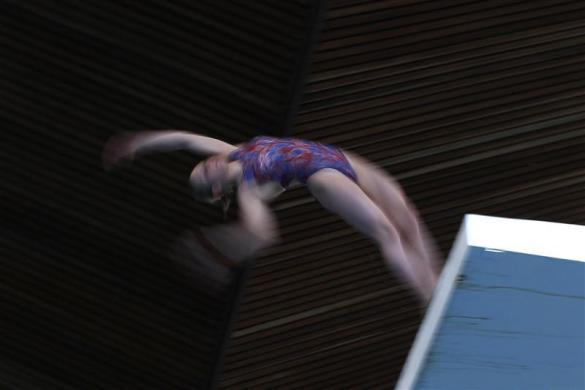 A member of Crystal Palace diving club dives during a training session in London March 9, 2012.