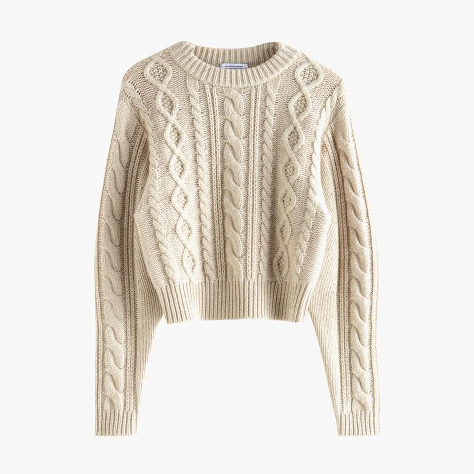 """$89, & OTHER STORIES. <a href=""""https://www.stories.com/en_usd/clothing/knitwear/sweaters/product.short-fitted-cable-knit-jumper-beige.0927679001.html"""" rel=""""nofollow noopener"""" target=""""_blank"""" data-ylk=""""slk:Get it now!"""" class=""""link rapid-noclick-resp"""">Get it now!</a>"""