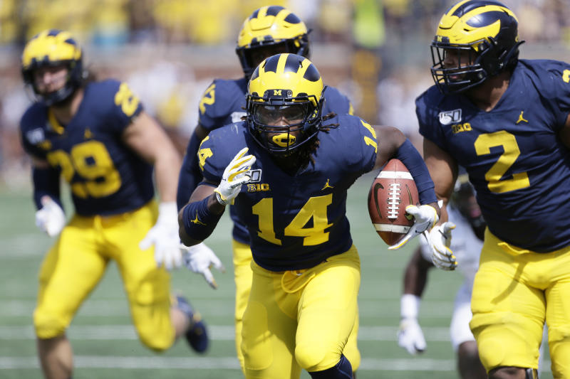 ANN ARBOR, MI - SEPTEMBER 7: Josh Metellus #14 of the Michigan Wolverines carries the ball against the Army Black Knights during the first half at Michigan Stadium on September 7, 2019 in Ann Arbor, Michigan. (Photo by Duane Burleson/Getty Images)