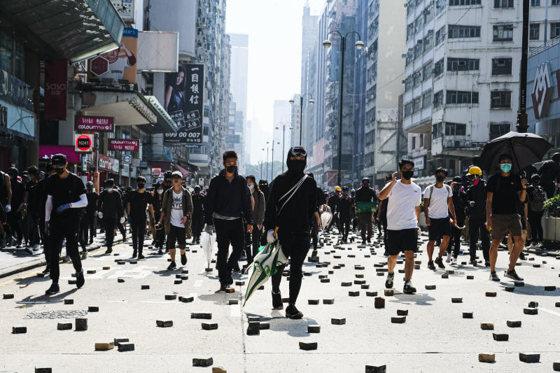 HONG KONG, CHINA - 2019/11/18: Protesters confront the police on Nathan Road during the demonstration. As a standoff continued in Hong Kong, protesters clashed with police near Hong Kong Polytechnic University in Kowloon, leading to multiple arrests and injuries. (Photo by Keith Tsuji/SOPA Images/LightRocket via Getty Images)
