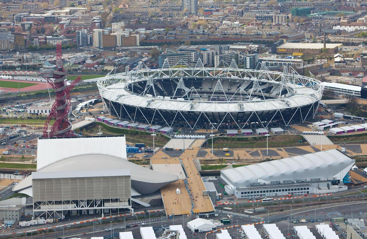 This is a handout photo dated Monday April 16, 2012 provided by LOCOG shows an aerial view of the Olympic Stadium and the sculpture the ArecelorMittal Orbit at left. Wednesday marks 100 days before the London 2012 Olympic Games begin. (AP Photo/Anthony Charlton/LOCOG)