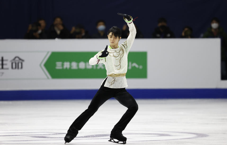 "FILE - In this Sunday, Feb. 9, 2020 file photo, Gold medalist Japan's Yuzuru Hanyu performs during the men's single free skating competition in the ISU Four Continents Figure Skating Championships in Seoul, South Korea. As Nathan Chen seeks a third straight World Figure Skating Championships title, something no American has achieved since Scott Hamilton got his fourth in a row in 1984, he has two major challenges in front of him. One is two-time Olympic gold medalist Yuzuru Hanyu of Japan, who Chen calls ""the benchmark."" The other is idleness in major competitions forced by the coronavirus pandemic. (AP Photo/Lee Jin-man, File)"