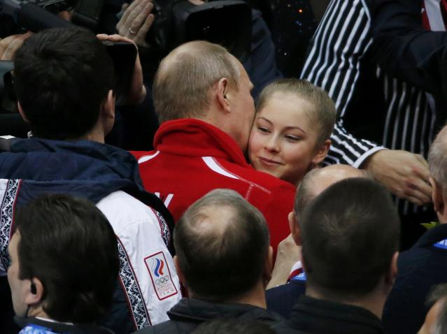 Yulia Lipnitskaya of Russia's figure skating team is greeted Russia's President Vladimir Putin at the Sochi 2014 Winter Olympics