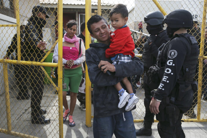 """Members of a Central American family leave a shelter in Piedras Negras, Mexico, Tuesday, Feb. 5, 2019. A caravan of about 1,600 Central American migrants camped Tuesday in the Mexican border city of Piedras Negras, just west of Eagle Pass, Texas. The governor of the northern state of Coahuila described the migrants as """"asylum seekers,"""" suggesting all had express intentions of surrendering to U.S. authorities. (Jerry Lara/The San Antonio Express-News via AP)"""