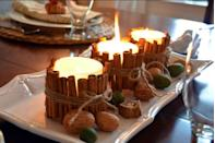 """<p>Want to bring the scent of the holidays into your home? Secure cinnamon sticks around a <a href=""""https://www.amazon.com/BOLSIUS-Pack-White-Pillar-Candles/dp/B004U3LZKM?tag=syn-yahoo-20&ascsubtag=%5Bartid%7C10055.g.2996%5Bsrc%7Cyahoo-us"""" rel=""""nofollow noopener"""" target=""""_blank"""" data-ylk=""""slk:candle"""" class=""""link rapid-noclick-resp"""">candle</a> with a rubber band, then tie with ribbon or twine, and you've got yourself the most sweet-smelling, rustic centerpiece. </p><p><a href=""""http://www.homestoriesatoz.com/holiday-ideas/cinnamon-stick-candles-fall-ideas.html"""" rel=""""nofollow noopener"""" target=""""_blank"""" data-ylk=""""slk:Get the tutorial at Home Stories A to Z »"""" class=""""link rapid-noclick-resp""""><em>Get the tutorial at Home Stories A to Z »</em></a></p>"""