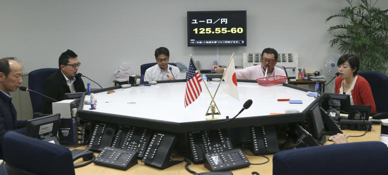 Foreign exchange brokers work in front of a screen displaying the day's euro rate equaling between 125.55 - 125.60 yen, at an office in Tokyo, Monday, Feb. 18, 2013. Last week, the yen fell to a near three-year low against the dollar and the euro. (AP Photo/Koji Sasahara)
