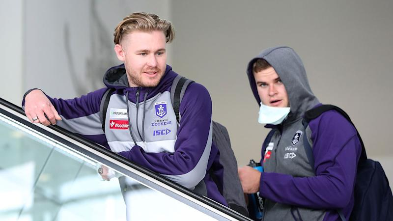 Seen here, Cam McCarthy with a Fremantle teammate at the airport.