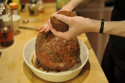 """<div class=""""caption-credit""""> Photo by: Sarah Shatz</div>Again using hands, pack brown sugar all over the exterior of the ham, pressing to ensure it adheres. Put bourbon in a spray bottle, and mist brown sugar coating to barely moisten. You may not use the entire 1/4 cup."""