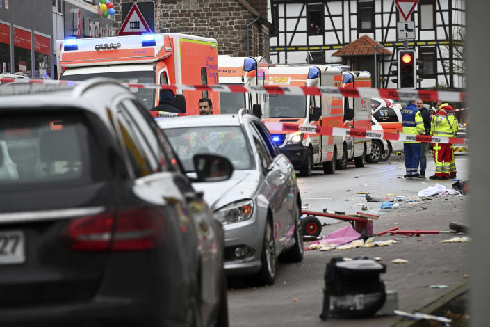 Emergency cars stand next to the scene of the accident with a car that is said to have crashed into a carnival parade in Volkmarsen, central Germany. (Uwe Zucchi/dpa via AP)