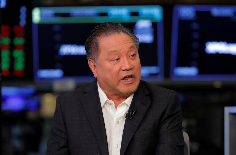 Hock Tan CEO of Broadcom speaks on the floor of the New York Stock Exchange shortly before the opening bell in New York