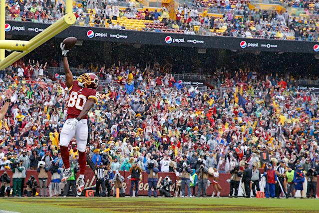 <p>Jamison Crowder #80 of the Washington Redskins celebrates after a touchdown in the second quarter against the Green Bay Packers at FedExField on September 23, 2018 in Landover, Maryland. (Photo by Todd Olszewski/Getty Images) </p>