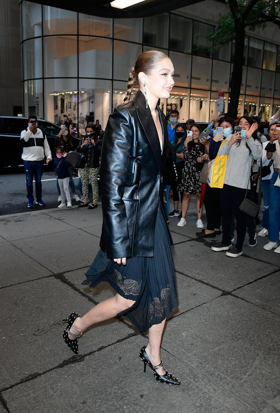 <p>The supermodel headed out in NYC in a slick leather blazer paired with a pretty pleated skirt. </p>