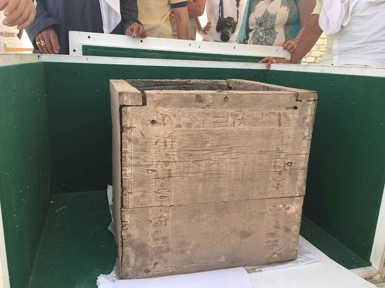 This wooden box was discovered inside the burial chamber of a 3,800-year-old pyramid and is inscribed with hieroglyphs that may mention the name of the daughter of pharaoh Ameny Qemau. The box once held the remains of jars containing the internal organs of a mummy. <cite>Courtesy of Egyptian Ministry of Antiquities</cite>