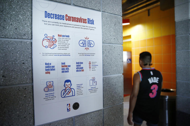 The NBA took steps to warn against spreading the coronavirus before postponing games indefinitely. (Michael Reaves/Getty Images)