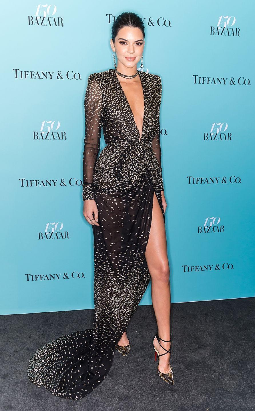 <p>Kendall Jenner wears a plunging gown by Redemption at Harper's BAZAAR 150th Anniversary Event</p>