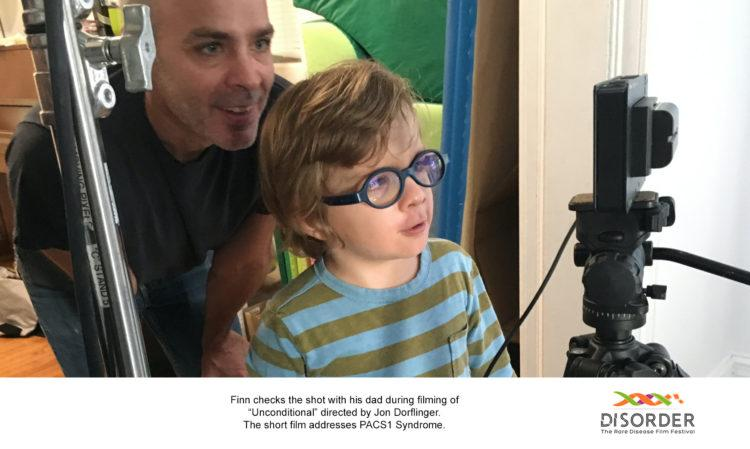 The filmmaker with their son, near the video camera