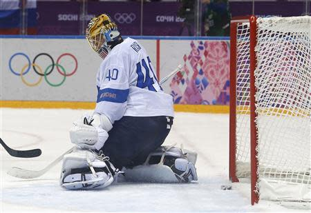Finland's goalie Tuukka Rask (40) lets in the game-winning overtime goal, scored by Canada's Drew Doughty (not shown), during their men's preliminary round ice hockey game at the Sochi 2014 Sochi Winter Olympics, February 16, 2014. REUTERS/Jim Young