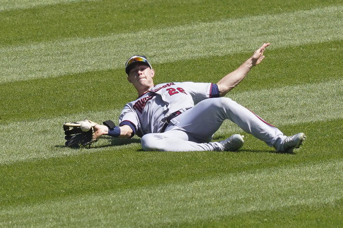 Minnesota Twins' Max Kepler is unable to catch a broken bat fly ball from Chicago White Sox's Yoan Moncada during the third inning of a baseball game Thursday, May 13, 2021, in Chicago. (AP Photo/Charles Rex Arbogast)