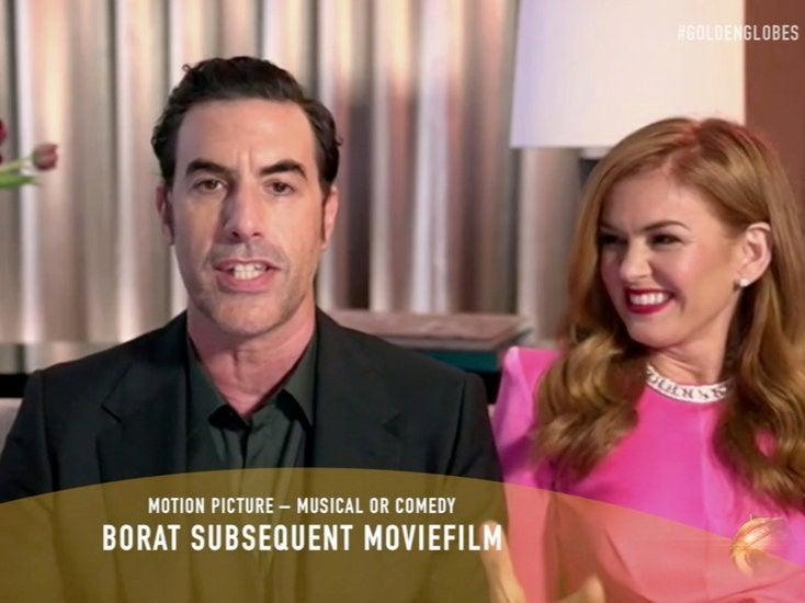 Scha Baron Cohen, with Isla Fisher, accepts the Best Picture prizevia Reuters