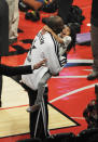Kobe Bryant hugs his daughter Gianna Maria-Onore Bryant during halftime of the NBA All-Star basketball game Sunday, Feb. 17, 2013, in Houston. (AP Photo/Pat Sullivan)