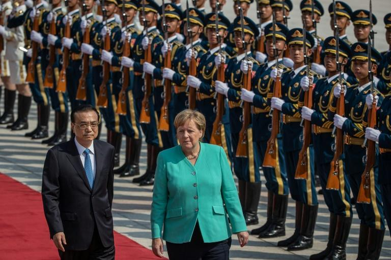 Protesters in Hong Kong have appealed to Angela Merkel to support them in her meetings with China's leadership