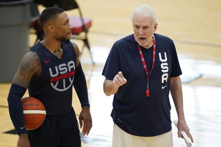head coach Gregg Popovich, right, speaks with Damian Lillard during training for USA Basketball, Tuesday, July 6, 2021, in Las Vegas. (AP Photo/John Locher)