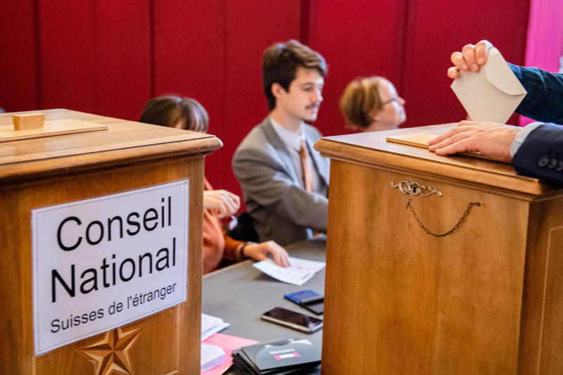 People are voting in the municipal office in Sion, Swizerland, on Sunday, Oct.20, 2019, during the 2019 Swiss Federal elections. (Olivier Maire/Keystone via AP)