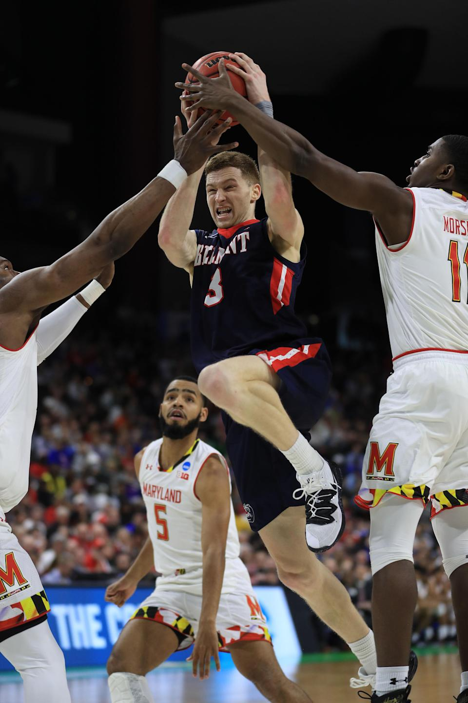 <p>Dylan Windler #3 of the Belmont Bruins is fouled by the Maryland Terrapins in the second half during the first round of the 2019 NCAA Men's Basketball Tournament at VyStar Jacksonville Veterans Memorial Arena on March 21, 2019 in Jacksonville, Florida. (Photo by Mike Ehrmann/Getty Images) </p>