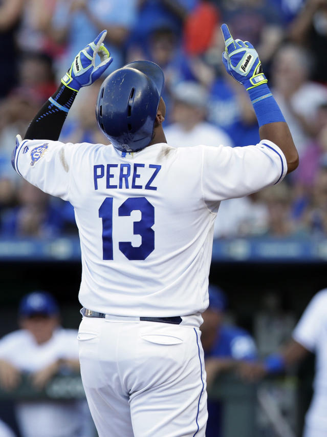Kansas City Royals' Salvador Perez gestures after his two-run home run during the first inning against the Minnesota Twins in a baseball game at Kauffman Stadium in Kansas City, Mo., Saturday, July 21, 2018. (AP Photo/Orlin Wagner)