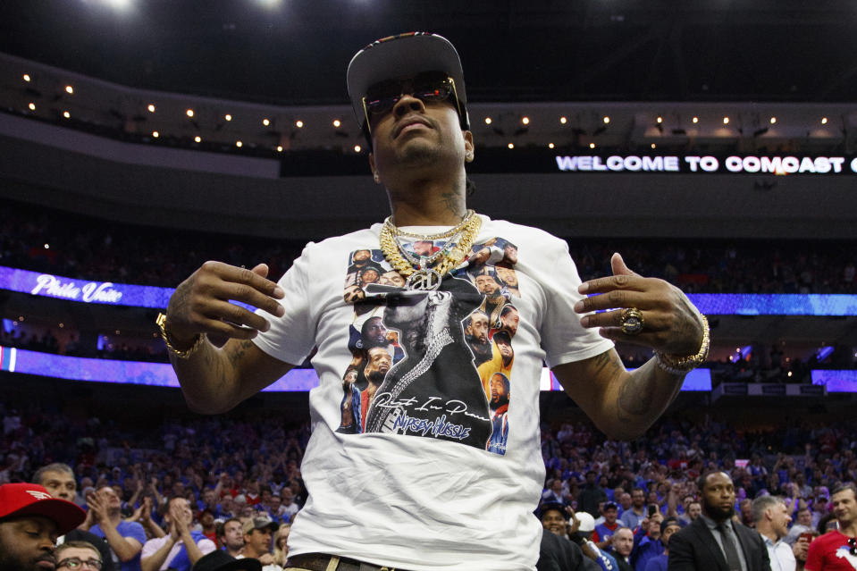 Former 76ers' Allen Iverson reacts to the crowd during the first half of Game 3 of a second-round NBA basketball playoff series against the Toronto Raptors, Thursday, May 2, 2019, in Philadelphia. 76ers won 116-95. (AP Photo/Chris Szagola)