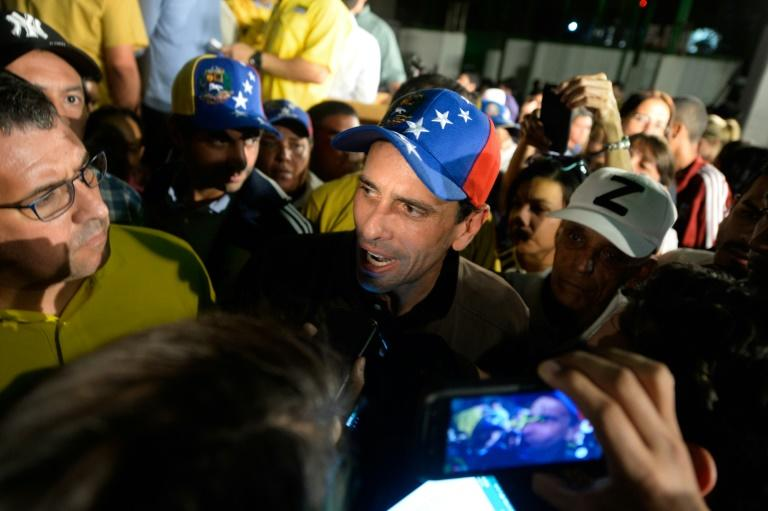 """Venezuelan opposition leader Henrique Capriles (C) told the media in Caracas """"If the dictatorship is squealing, it is a sign that we are making progress"""""""