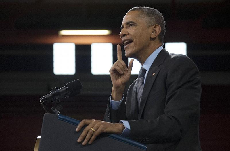US President Barack Obama delivers remarks on the new steps he will be taking within his executive authority on immigration at Del Sol High School in Las Vegas, Nevada, November 21, 2014 (AFP Photo/Jim Watson)