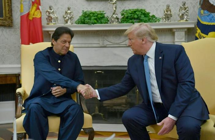 US President Donald Trump praised Pakistan for its help in advancing peace talks in Afghanistan as he hosted Prime Minister Imran Khan in the Oval Office on July 22, 2019 (AFP Photo/Nicholas Kamm)