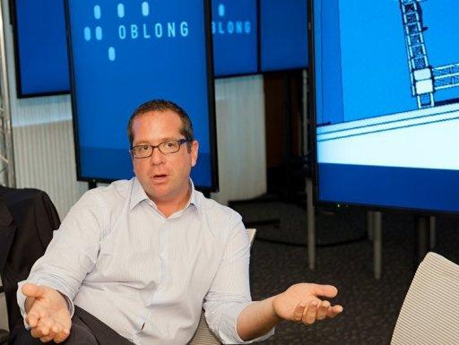 """David Schwartz, Oblong Industries vice president for sales, speaks at the Washington offices of the Los Angeles-based software company in June 2012. The software behind the film """"Minority Report"""" -- where Tom Cruise speeds through video on a large screen using only hand gestures -- is making its way into the real world"""