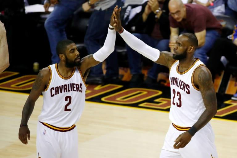 Kyrie Irving (L) and LeBron James of the Cleveland Cavaliers high five against the Golden State Warriors in Game 4 of the 2017 NBA Finals at Quicken Loans Arena on June 9, 2017 in Cleveland, Ohio