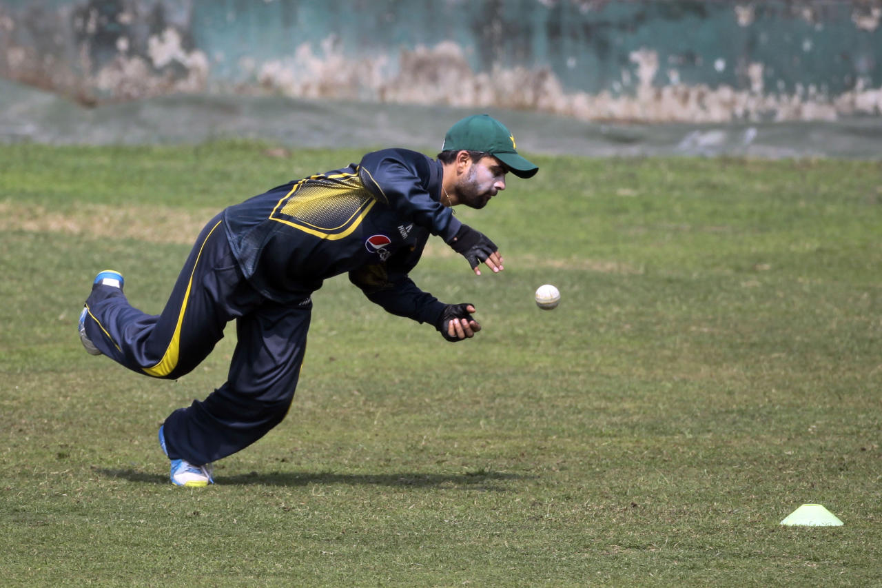 Pakistan's Ahmed Shehzad takes a catch during a practice session ahead of the Asia Cup tournament in Dhaka, Bangladesh, Monday, Feb. 24, 2014. Pakistan plays Sri Lanka in the opening match of the five nation one day cricket event that begins Tuesday. (AP Photo/A.M. Ahad)