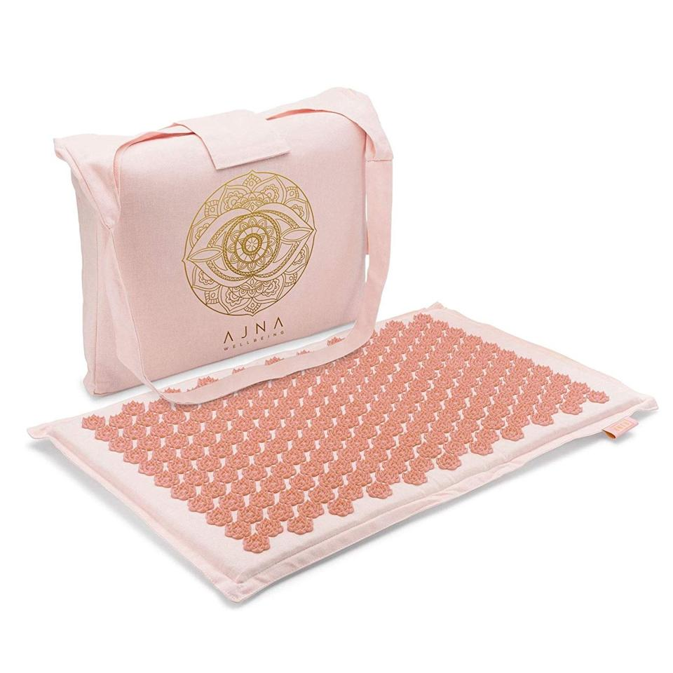 """<p>You can't go wrong with an acupressure mat studded with thousands of tiny, ergonomically engineered spikes that reviewers swear help relieve back pain, soothe stress, and even improve sleep. We particularly love Ajna's Accupressure Mat, which promises gentle pressure to boost circulation, help with <a href=""""https://www.allure.com/gallery/best-acupressure-mats?mbid=synd_yahoo_rss"""" rel=""""nofollow noopener"""" target=""""_blank"""" data-ylk=""""slk:lymphatic drainage"""" class=""""link rapid-noclick-resp"""">lymphatic drainage</a>, and even re-energize tired, sagging skin. This is a great gift for the overworked friend who still hasn't figured out work-life balance during this less-than-normal year.</p> <p><strong>$32</strong> (<a href=""""https://www.amazon.com/dp/B07Y4TC9YB/ref=twister_B07JLBG2SY?_encoding=UTF8&psc=1"""" rel=""""nofollow noopener"""" target=""""_blank"""" data-ylk=""""slk:Shop Now"""" class=""""link rapid-noclick-resp"""">Shop Now</a>)</p>"""