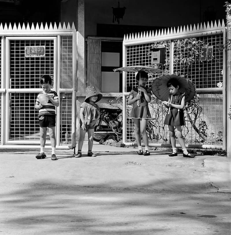 Mr Lim's children outside their home. Photo: Lim Kwong Ling