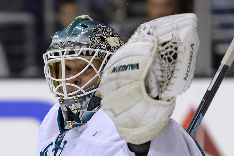 San Jose Sharks goalie Antti Niemi, of Finland, makes a glove-save during the second period of their NHL hockey game against the Los Angeles Kings, Wednesday, Oct. 30, 2013, in Los Angeles. (AP Photo/Mark J. Terrill)