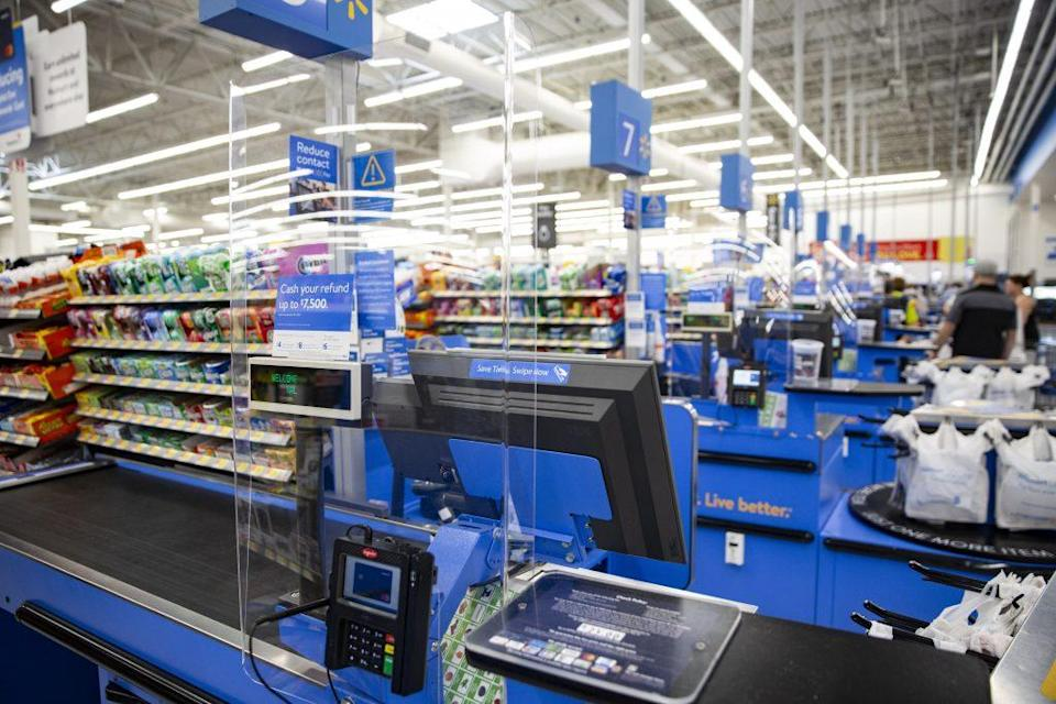 Plexiglass barriers are seen at the checkout lanes at a Walmart store. - Credit: Wesley Hitt/Courtesy of Walmart