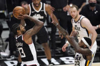 Los Angeles Clippers guard Paul George, left, shoots as Utah Jazz forward Royce O'Neale defends during the second half of Game 3 of a second-round NBA basketball playoff series Saturday, June 12, 2021, in Los Angeles. (AP Photo/Mark J. Terrill)