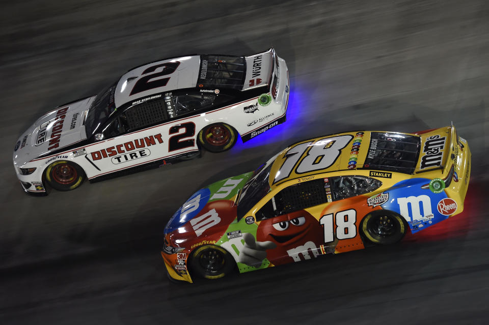 BRISTOL, TENNESSEE - JULY 15: Kyle Busch, driver of the #18 M&M's Toyota, races Brad Keselowski, driver of the #2 Discount Tire Ford, during the NASCAR Cup Series All-Star Race at Bristol Motor Speedway on July 15, 2020 in Bristol, Tennessee. (Photo by Jared C. Tilton/Getty Images)