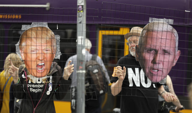 <p>Protesters hold photos of President Donald Trump and Vice President Mike Pence during a protest, Monday, July 9, 2018, in Seattle, by the group Refuse Fascism, who were demonstrating against Trump and his choice of federal appeals Judge Brett Kavanaugh for Trump's second nominee to the Supreme Court. (Photo: Ted S. Warren/AP) </p>