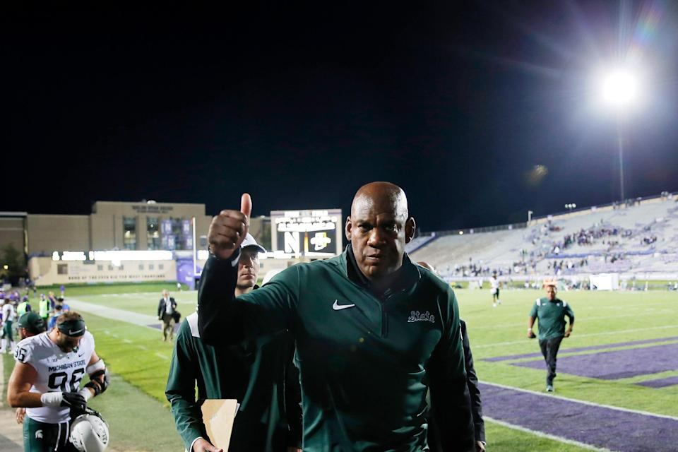Michigan State coach Mel Tucker gives a thumbs up to fans as he walks off the field after defeating Northwestern at Ryan Field, 38-21, on Friday Sept. 3, 2021 in Evanston, Illinois.