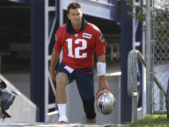 New England Patriots quarterback Tom Brady steps on the field at the start of an NFL football training camp practice, Thursday, July 25, 2019, in Foxborough, Mass. (AP Photo/Steven Senne)