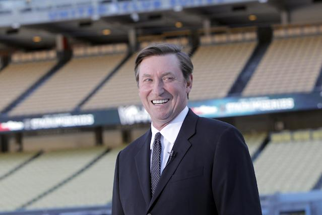Former NHL player, Wayne Gretzky speaks about the Dodger Stadium upcoming 2014 NHL Stadium Series hockey game in Los Angeles, on Monday, Jan. 13, 2014. An ice skating rink is being built for the 2014 NHL Stadium Series Los Angeles game between the Kings and Ducks at Dodger Stadium on Jan. 25. (AP Photo/Nick Ut)