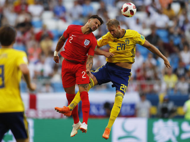 <p>Sweden's Ola Toivonen, right, and England's Kyle Walker challenge for the ball </p>