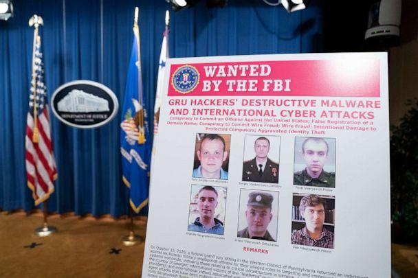 PHOTO: A poster showing six wanted Russian military intelligence officers is displayed before a news conference at the Department of Justice, on Oct. 19, 2020 in Washington, DC. (Getty Images)